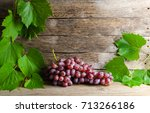 vine and green leaves rests on... | Shutterstock . vector #713266186