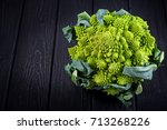 fresh romanesco cabbage closeup ... | Shutterstock . vector #713268226