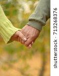 elderly couple holding hands   Shutterstock . vector #713268376