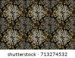 golden pattern on black... | Shutterstock . vector #713274532