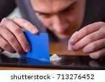 drug addict businessman in the... | Shutterstock . vector #713276452