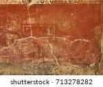 Small photo of Fresco in a wall of t Fullonica Di Stephanus in Via della Abbondanza at Ruins of Pompeii. The city was an ancient Roman city destroyed by the volcano Vesuvius. Pompei, Campania, Italy.