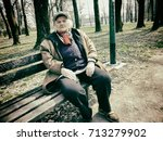 an old lady resting on a bench... | Shutterstock . vector #713279902
