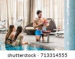 seductive young man serving... | Shutterstock . vector #713314555