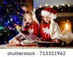 happy little sisters reading a... | Shutterstock . vector #713321962