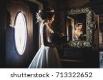 young beautiful bride with a... | Shutterstock . vector #713322652