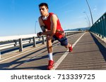young athlete man stretching... | Shutterstock . vector #713339725