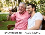 dad and son taking selfie and... | Shutterstock . vector #713342242