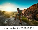 woman hiking at red rock canyon ... | Shutterstock . vector #713355415