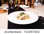 penne pasta with chicken and... | Shutterstock . vector #713357422
