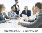 meeting of business partners... | Shutterstock . vector #713394952
