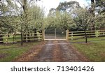 Rural Driveway And Gates With...