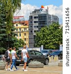 Small photo of People walk in the city. Building of PWC company in Sofia. Insurance, advisory, tax service. Urban cityscape of European cities. Bulgaria, Sofia - June 10, 2017