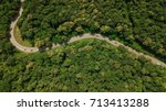 Aerial top view top view of the road through the trees,  - stock photo