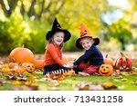 Children In Black And Orange...