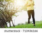 young lady running on a rural... | Shutterstock . vector #713436166