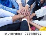 asian business employees hug... | Shutterstock . vector #713458912