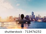 a man relax in swimming pool in ... | Shutterstock . vector #713476252
