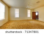 A very old empty living room with yellow walls. Build in 1907 old farm house in Ashford, Washington State near Mt. Rainier. Have been neglected for many years. - stock photo