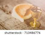 holy communion on wooden table... | Shutterstock . vector #713486776