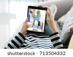 woman hand using tablet with... | Shutterstock . vector #713504332