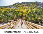 hike woman with backpack... | Shutterstock . vector #713507566