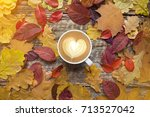 a cup of coffee with cappuccino ... | Shutterstock . vector #713527042