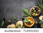 olives  olive oil rosemary and... | Shutterstock . vector #713531452
