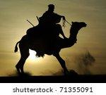 A Silhouette Of A Tuareg Rider...