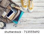 backpack with school supplies | Shutterstock . vector #713555692
