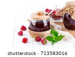 raspberry confiture in can with ... | Shutterstock . vector #713583016