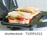 sandwich toaster with toast and ... | Shutterstock . vector #713591212