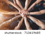 group of friends with stack of... | Shutterstock . vector #713619685
