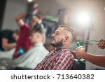 shot of a bearded handsome... | Shutterstock . vector #713640382