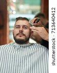 vertical shot of a handsome... | Shutterstock . vector #713640412