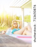Small photo of Colorful portrait of pretty young woman in swimsuit lying on air bed in the swimming pool. Vacation concept. Enjoying the summer.