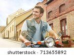 cheerful young man is riding on ... | Shutterstock . vector #713655892