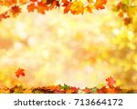 autumn background with maple... | Shutterstock . vector #713664172