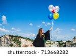 a girl handing balloon with...   Shutterstock . vector #713668282