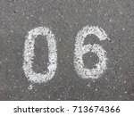 number six  painted on asphalt | Shutterstock . vector #713674366