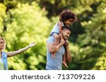 portrait of young father... | Shutterstock . vector #713709226