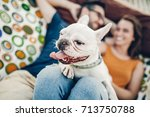 Stock photo happy hipster couple with bulldog relaxing in hammock on the beach in sunset light summer vacation 713750788