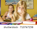 a cold girl in school | Shutterstock . vector #713767258