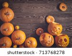 Halloween Pumpkins Over Wooden...