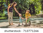 two happy brothers in yellow... | Shutterstock . vector #713771266