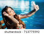 girl takes selfie sitting by... | Shutterstock . vector #713775592