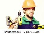 builder in orange helmet and... | Shutterstock . vector #713788606