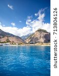 Small photo of Panoramic view of Crete (Greece) mountains of Libyan Sea side. driving with a boat along from Samaria gorge towards Loutro village. In background village Agia Roumeli.