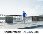 athletic senior man jogging in... | Shutterstock . vector #713829688