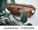Brown Cosmetic Bag On White...